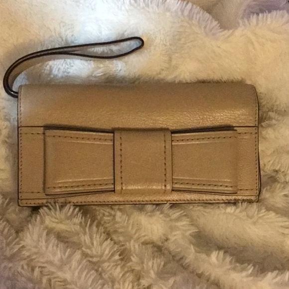 kate spade Handbags - ♠️Kate Spade Leather Lacey bow wallet/wristlet♠️